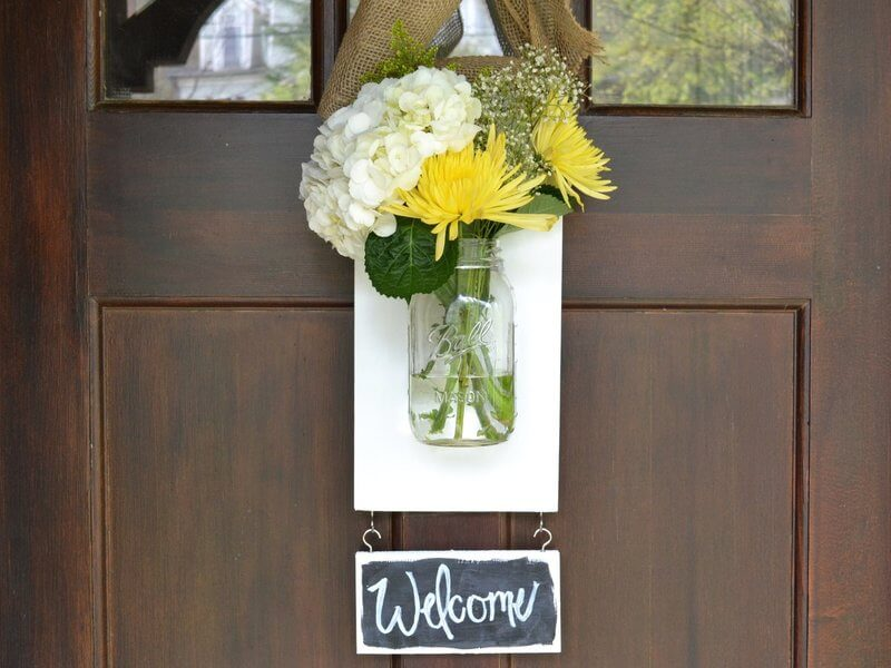 Mason Jar Flowers on a Welcome Sign