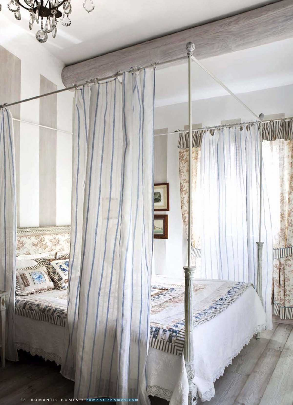 Curtained Four Poster Bed with Mixed Patterns