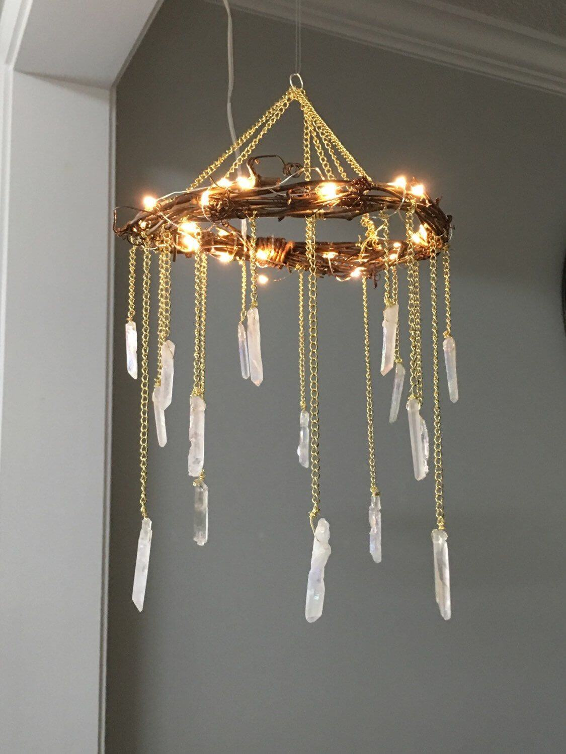 White Stones Dangling from Gold Chandelier