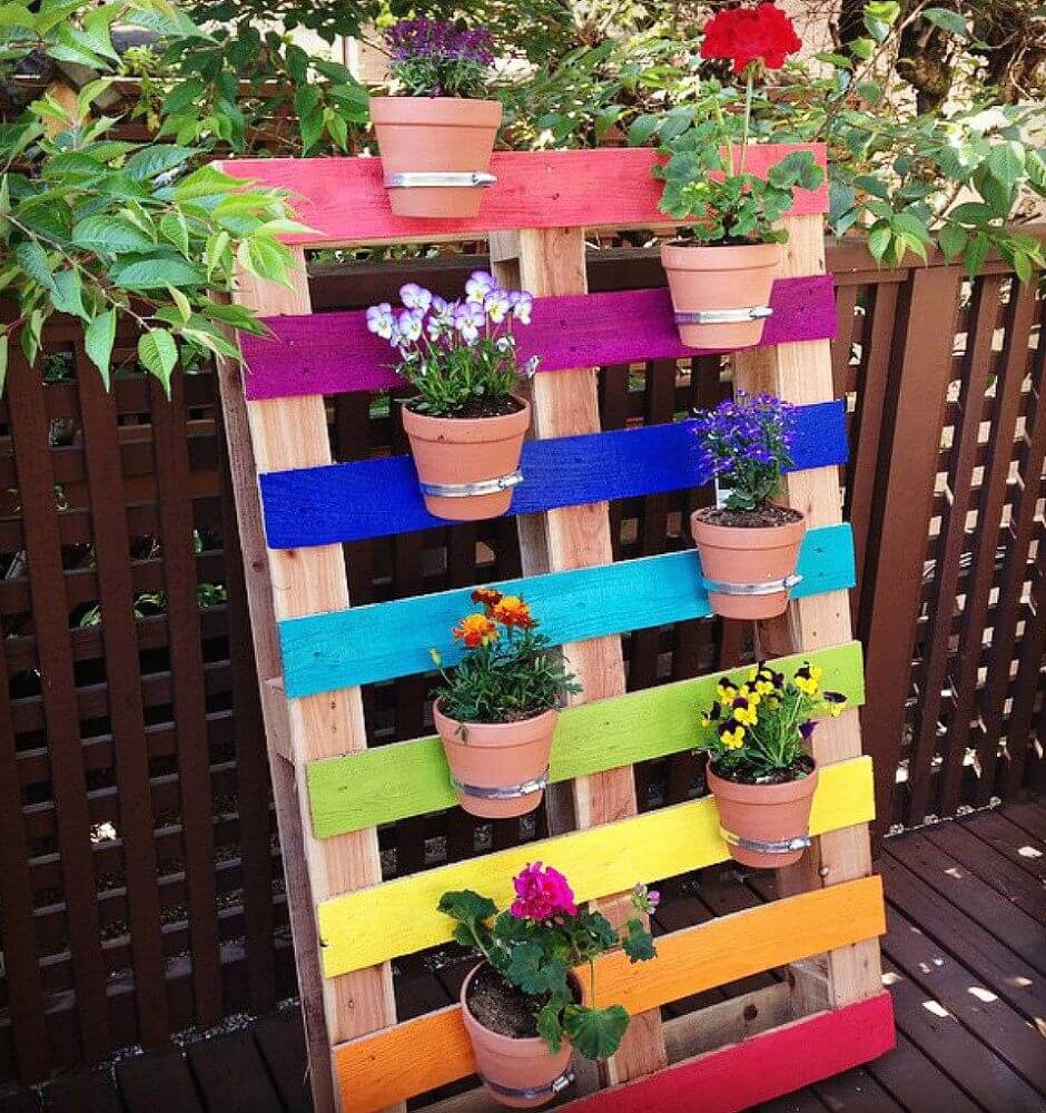 Rainbow-Colored Pallet Hangs Flower Pots