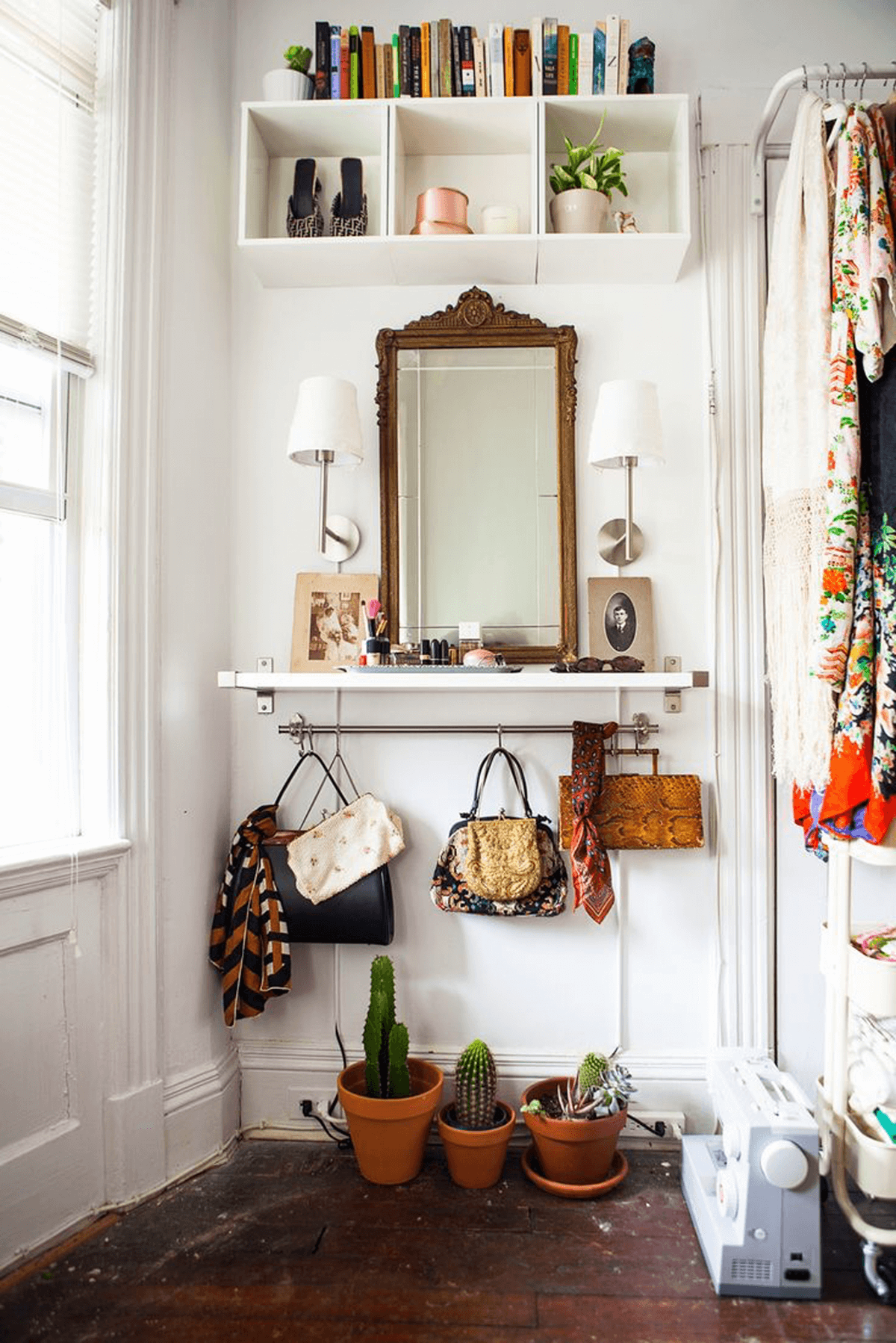 4 antique mirror hangs above suspended vanity table