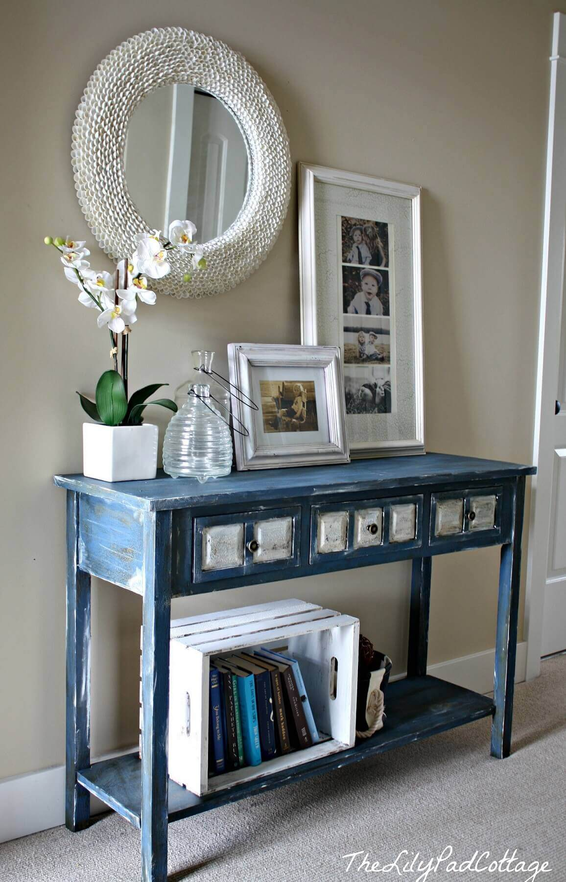white dcor accents on distressed blue entry