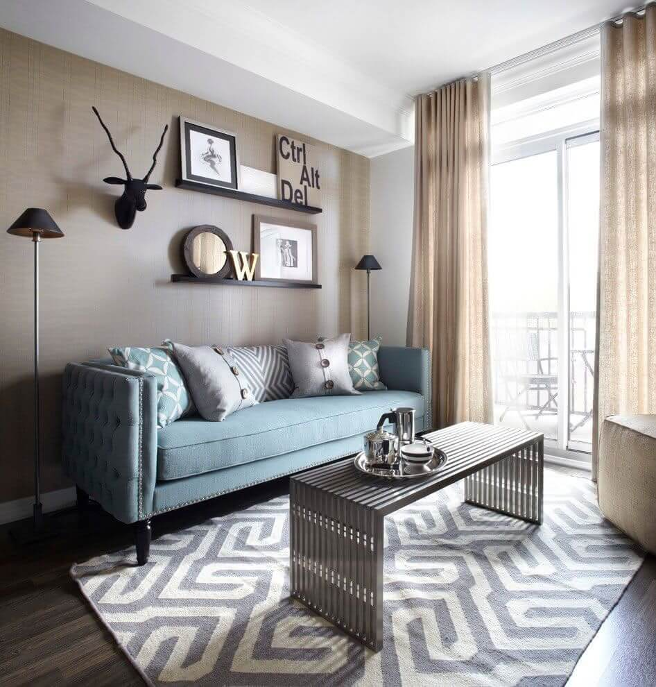Calming Blue Sofa and Geometric Rug