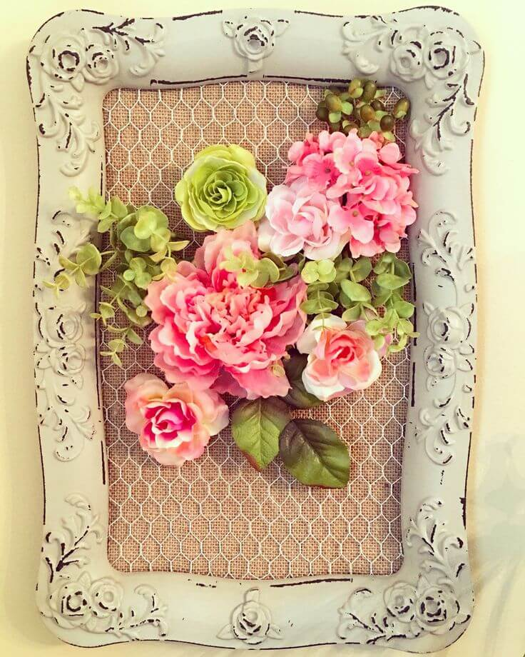Upcycled Mirror Frame Holding Flowers