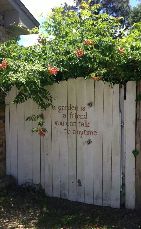 Stenciled Message on a Whitewashed Garden Gate