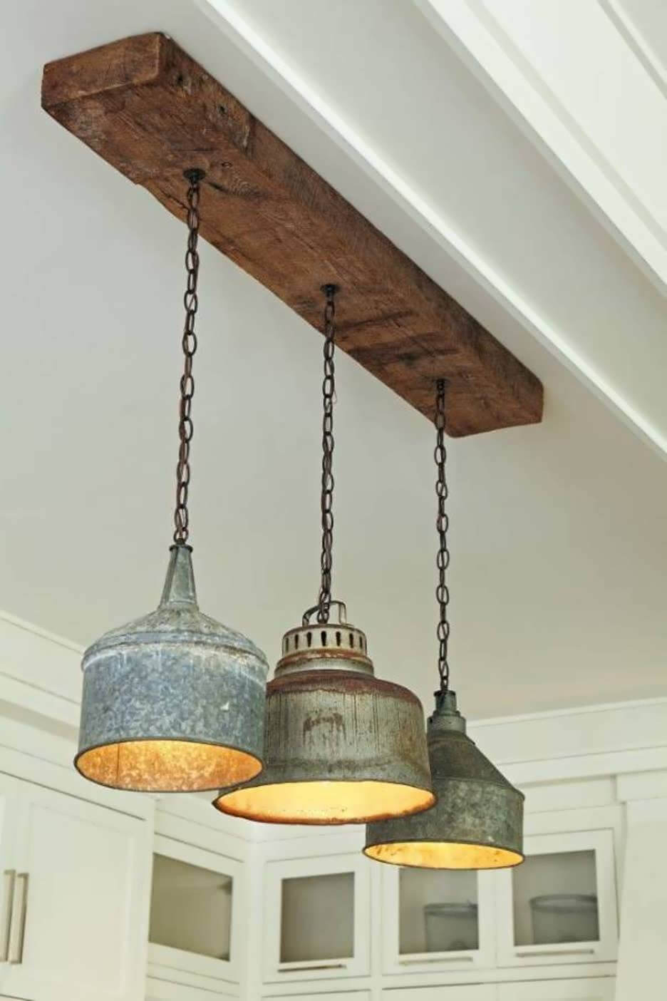 Antique Metal Fixtures Hanging from Timber Beam