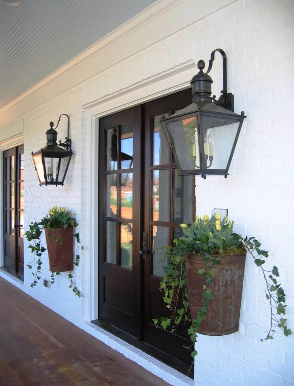 Rusty Metal Planters by the Door