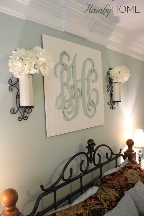 Flowers in Sconces Accompany Scrolled Initials