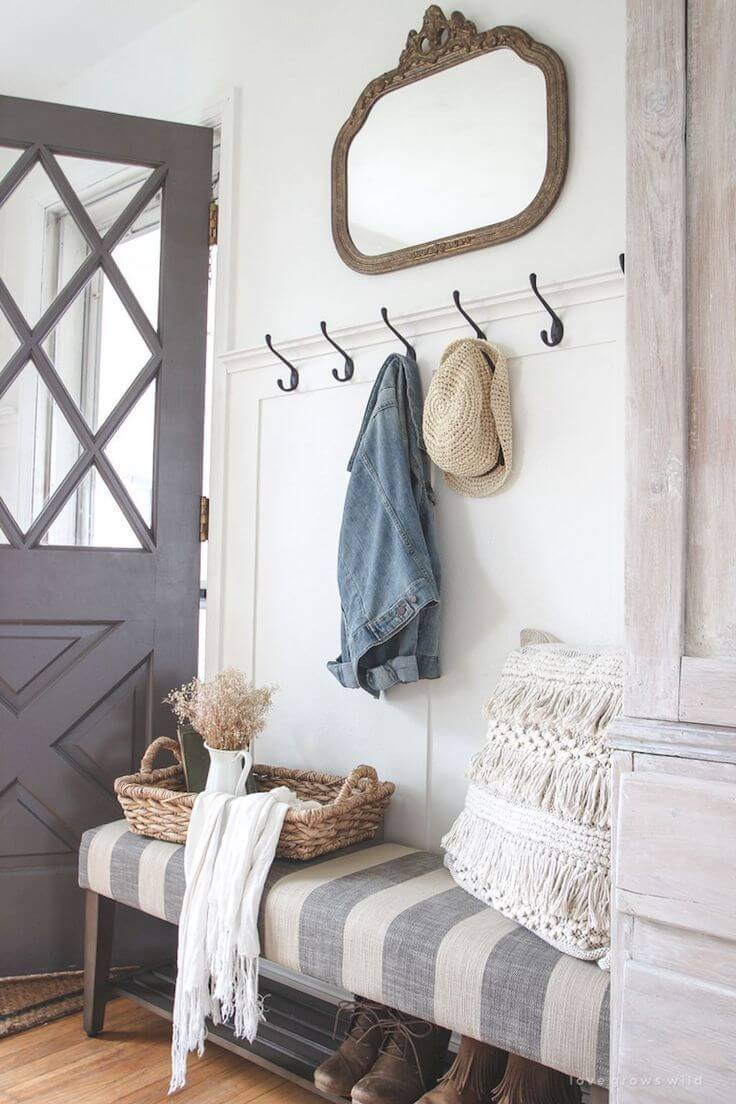 Wall Hooks on White and Gray-Striped Bench