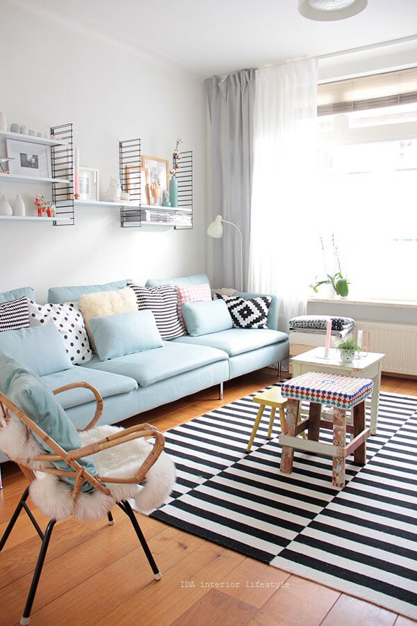 Sky Blue Sofa with Bold Striped Rug