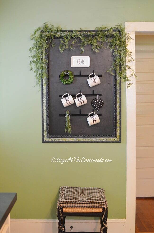 Framed Arrangement with Hooks and Greenery