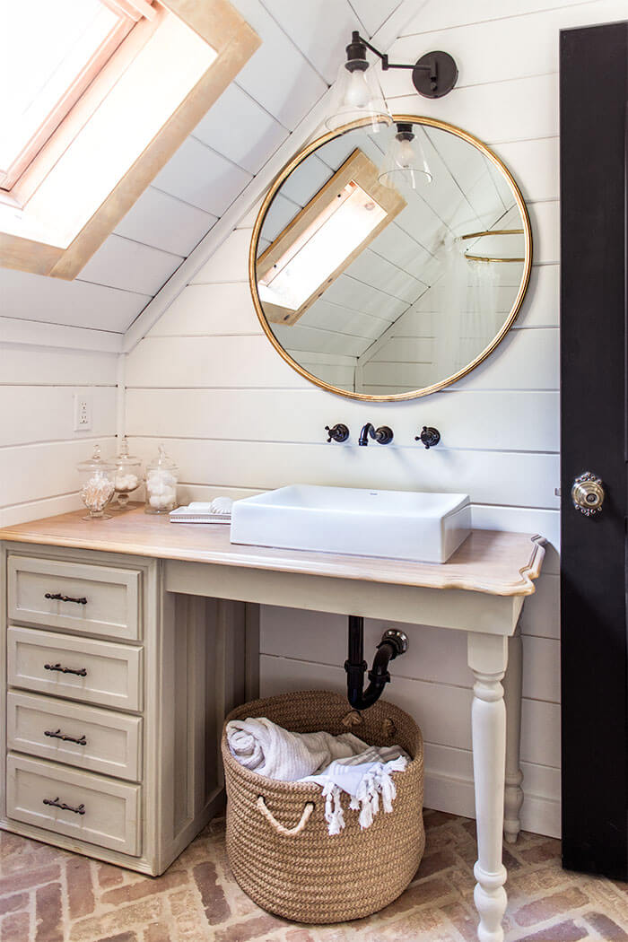 Cottage Style Bathroom Idea with Brick Floors