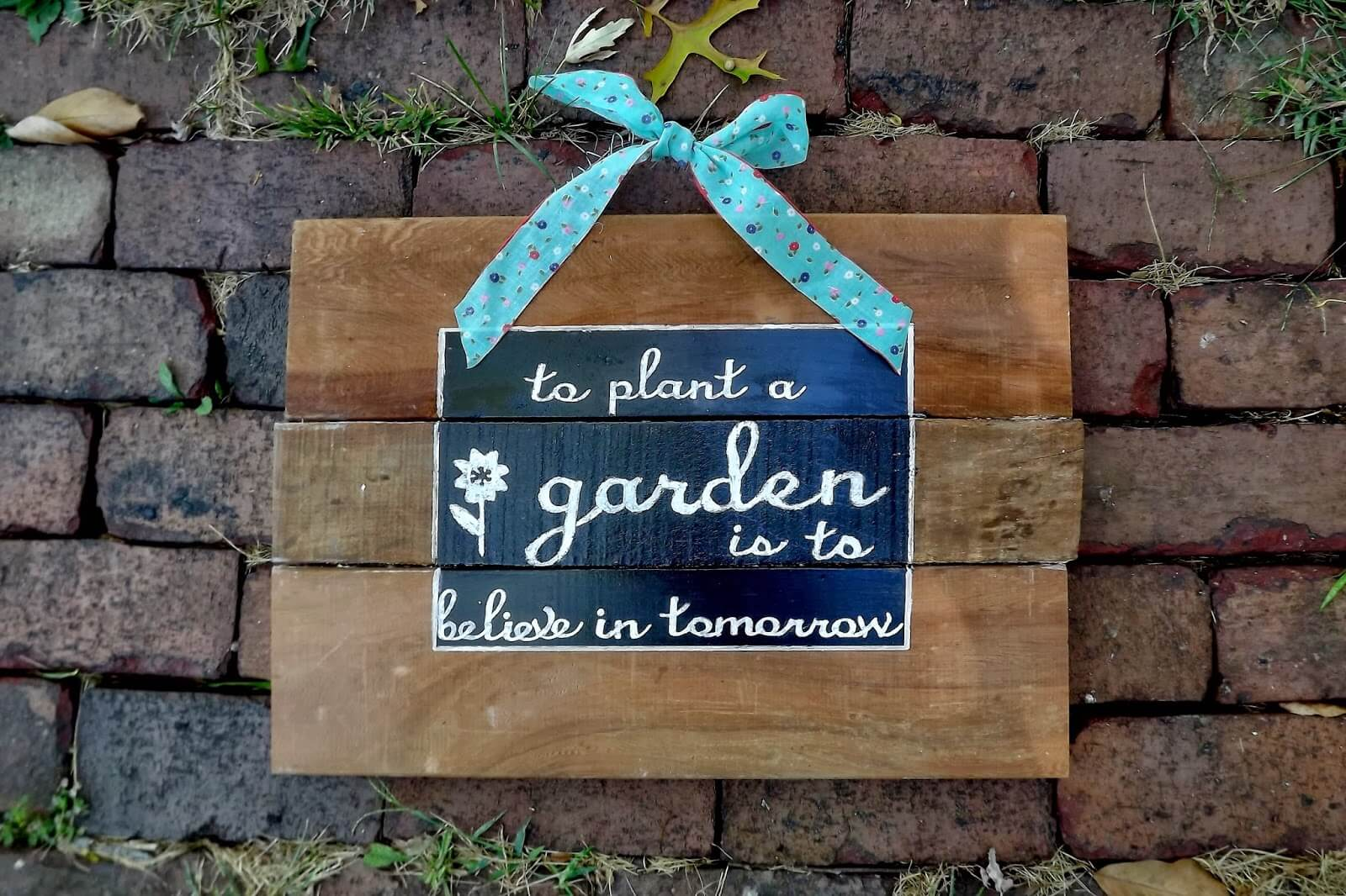 Thoughtful Painted Sign for the Garden Wall