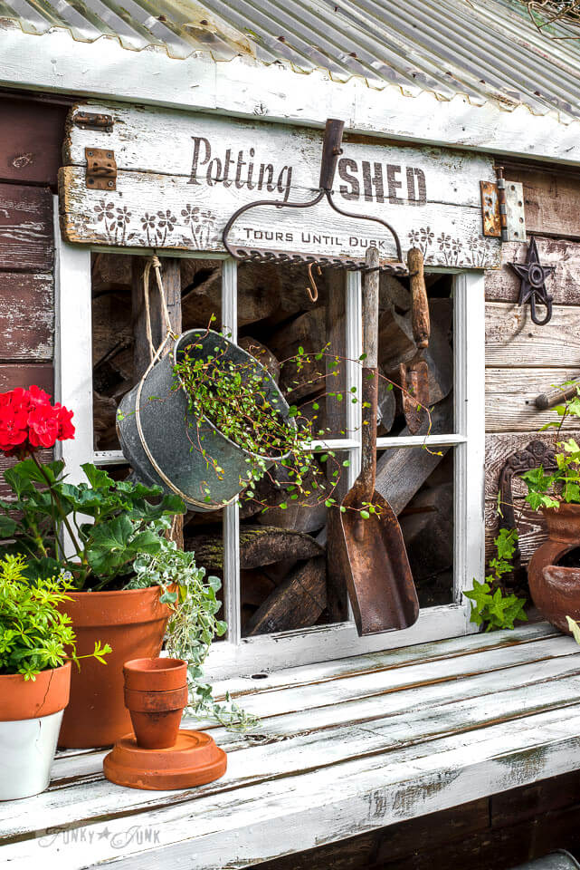 Potting Bench with Fun Sign and Old Rake