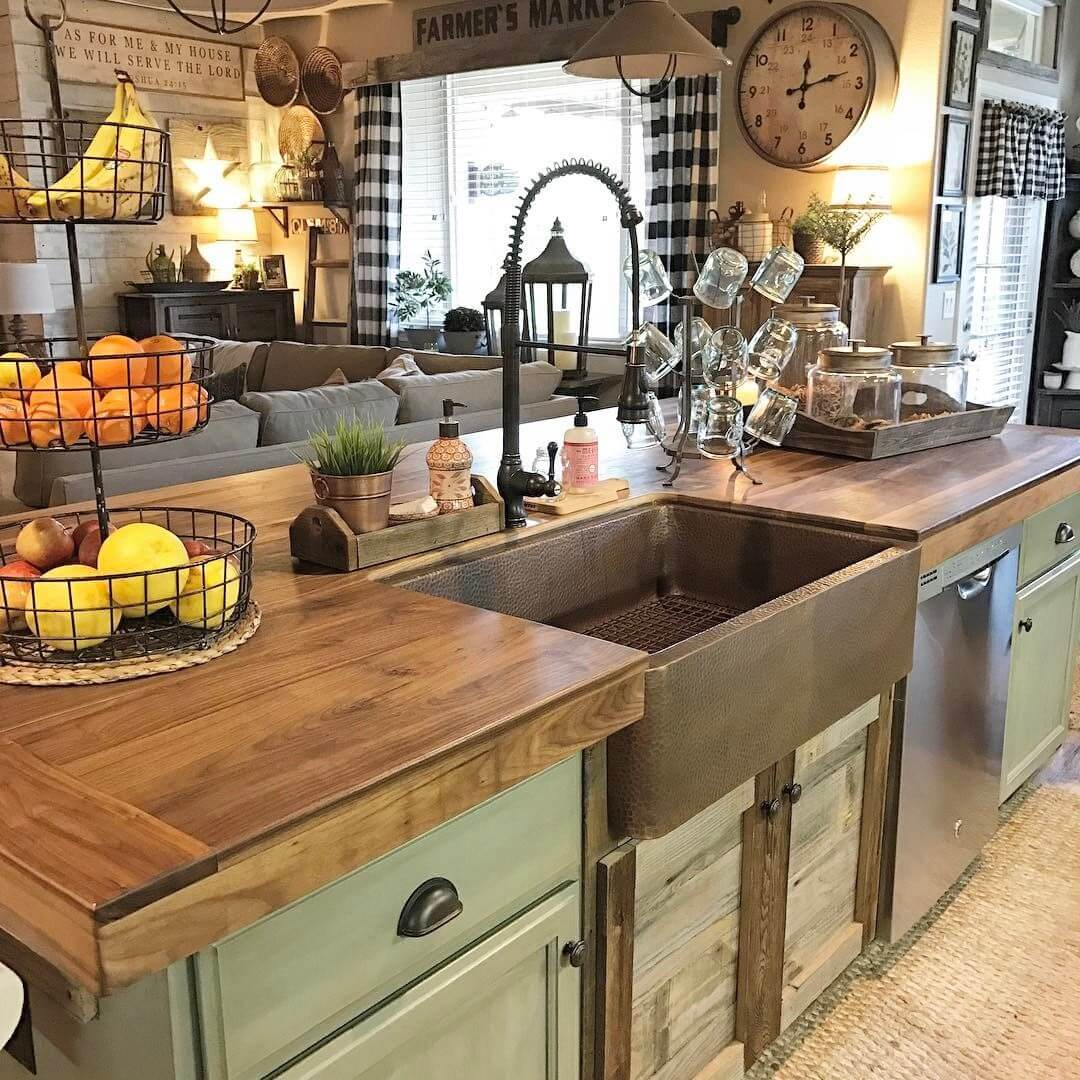 Copper toned sink in the island