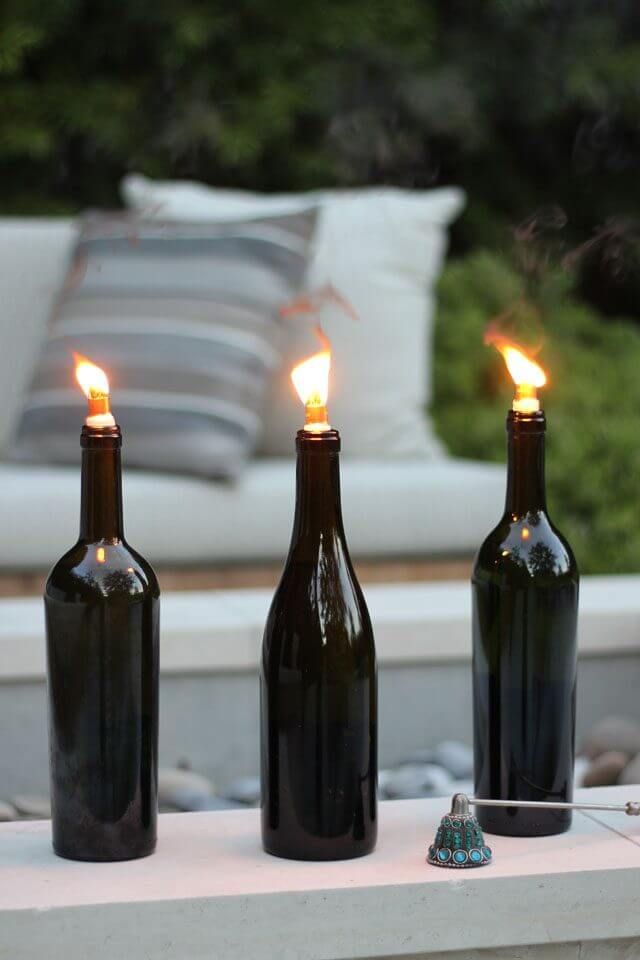 25 best diy outdoor lighting ideas and designs for 2018 2 make wine bottle torch lamps mozeypictures Image collections
