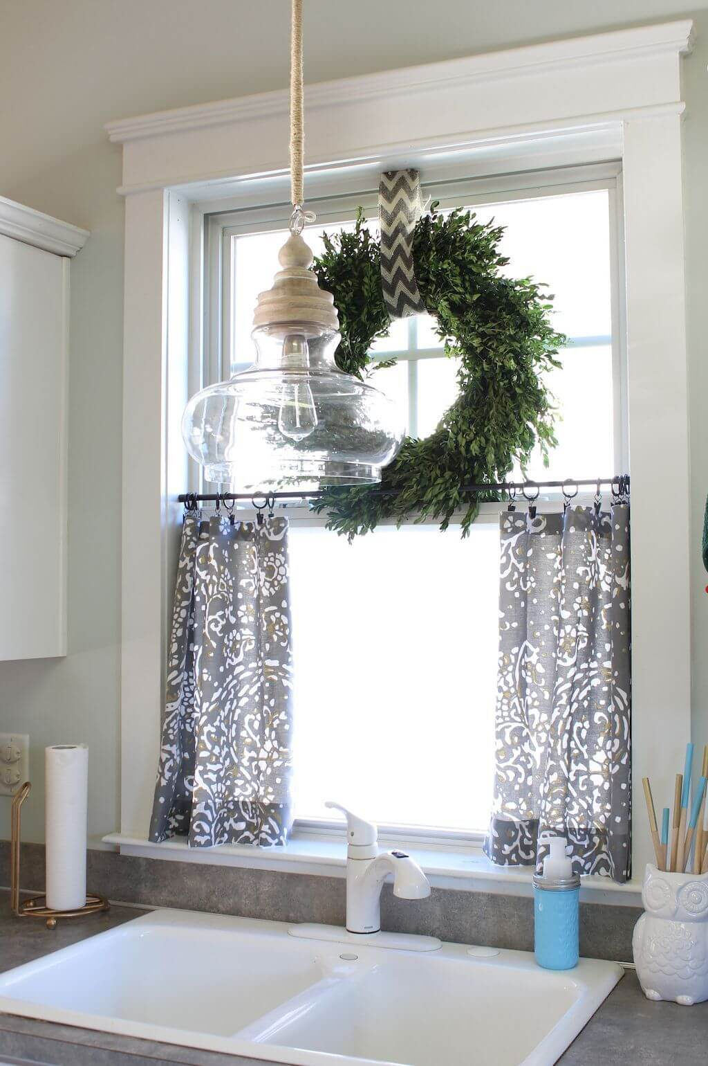 Dove gray café curtains and a wreath