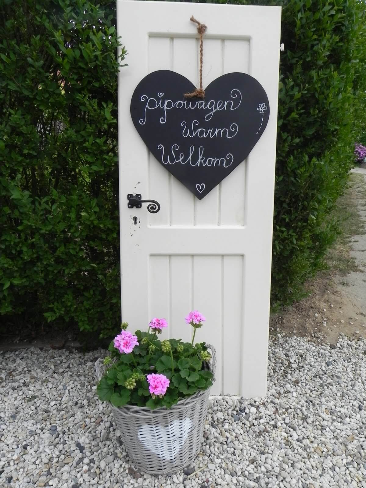 Old Door Outdoor Decor Idea with Chalkboard Signs