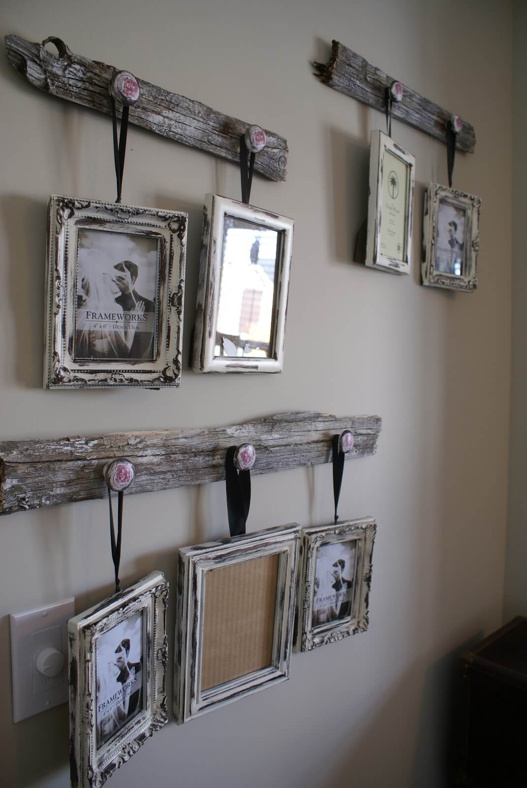 Distressed Frames Hanging from Reclaimed Wood