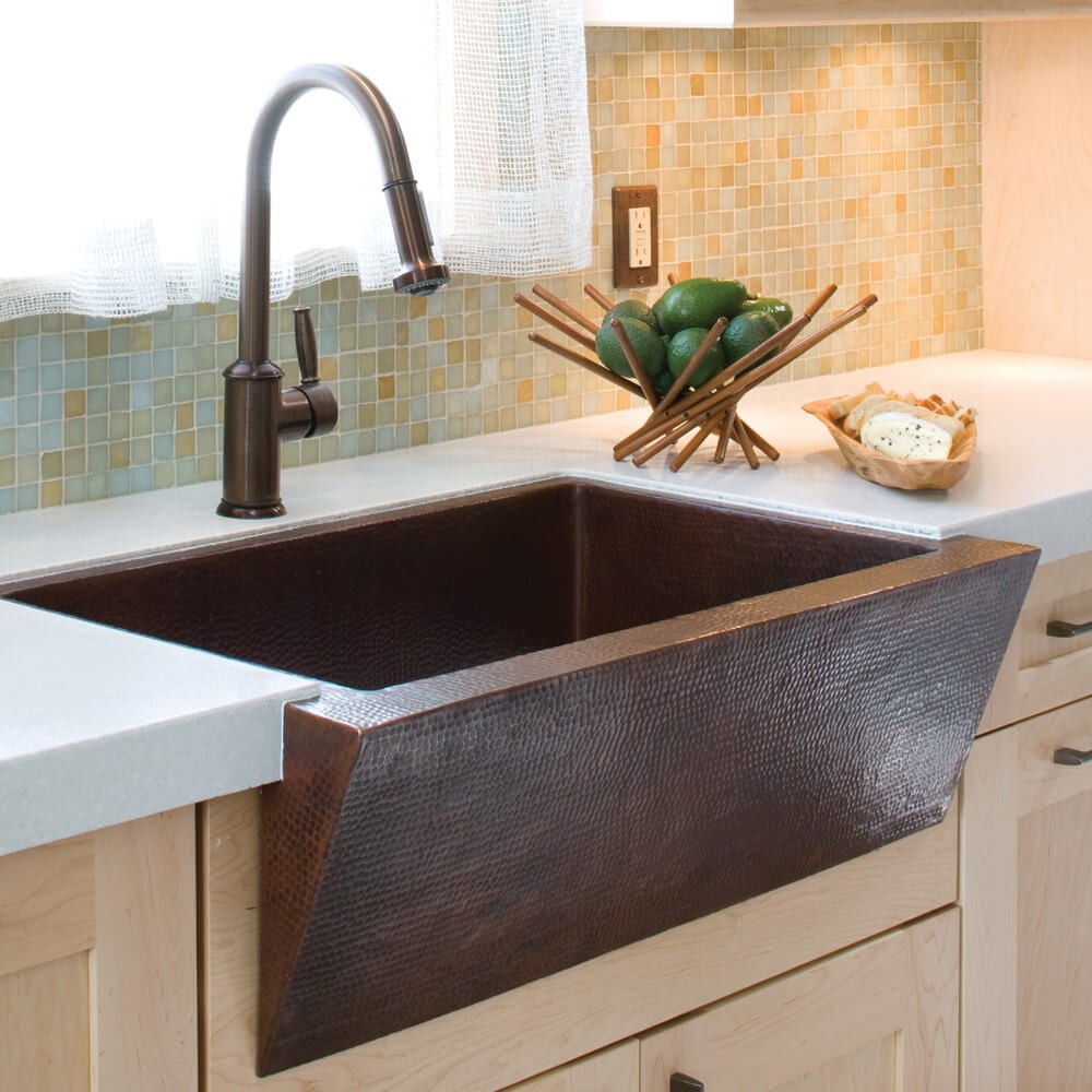 Gracefully Angled Hammered Kitchen Sink