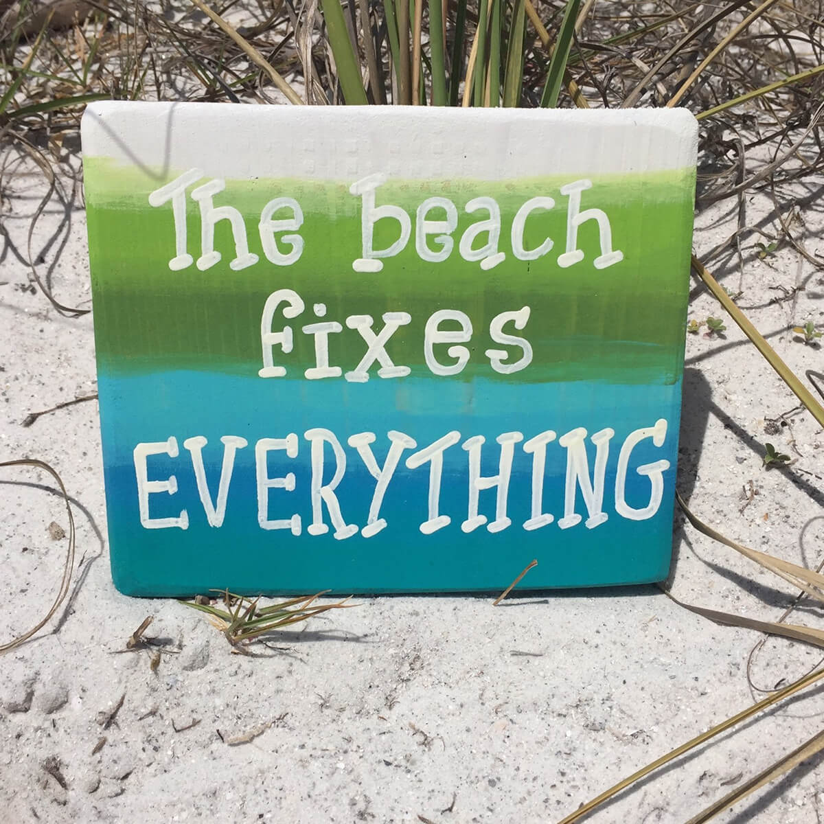Green, Blue, and White Beach Sign