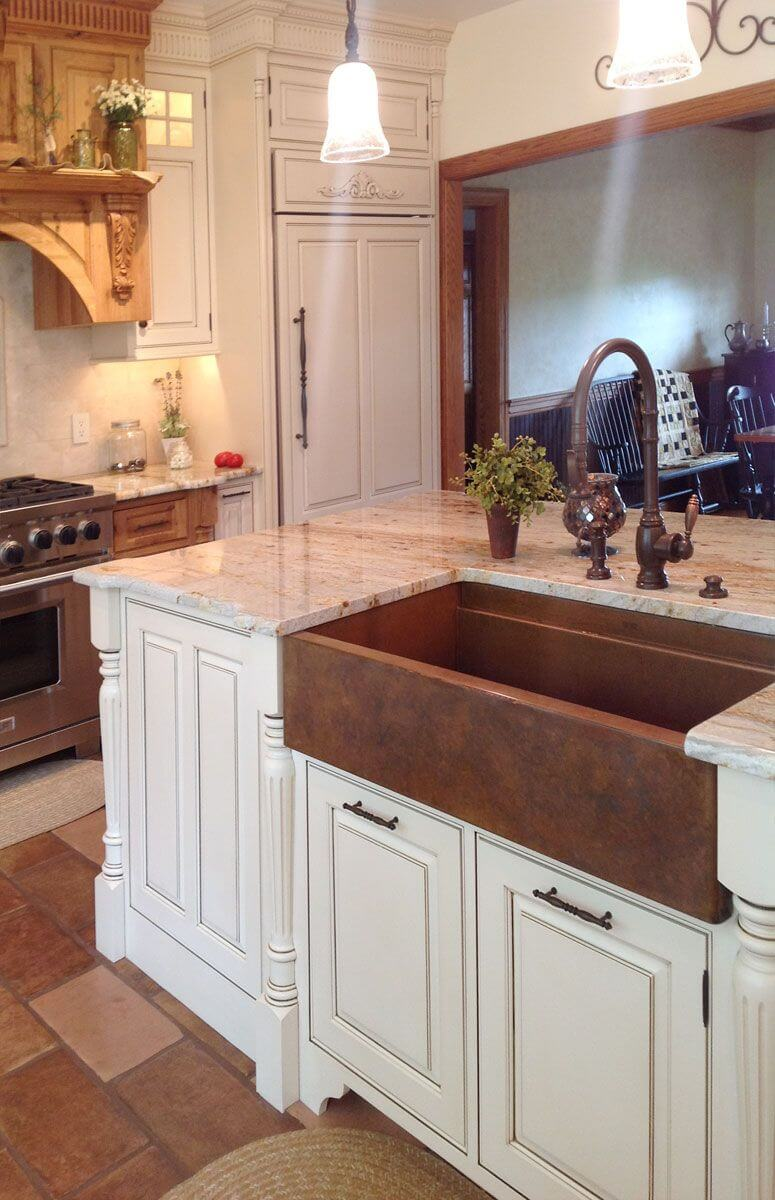 Marble Countertop and Beaten Copper Sink