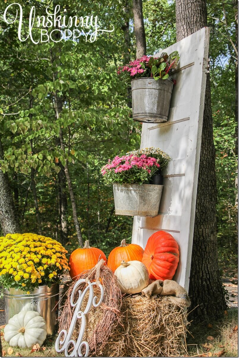 Fall Display with Mums and Pumpkins