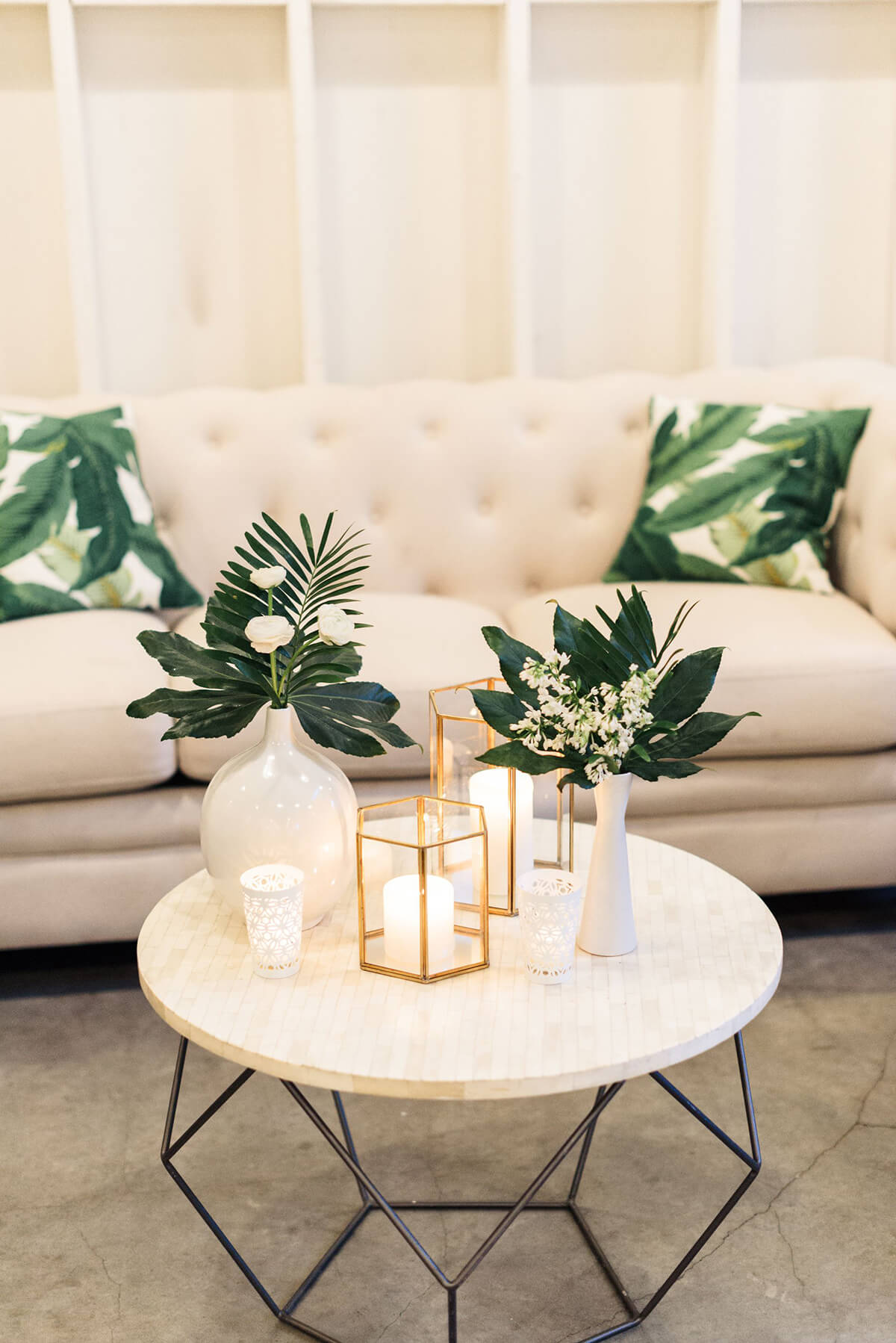Elegant Candles, Foliage, and Flower Arrangement