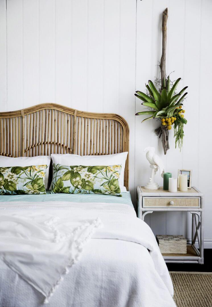 Relaxing Bedroom with Wicker Headboard and Plants
