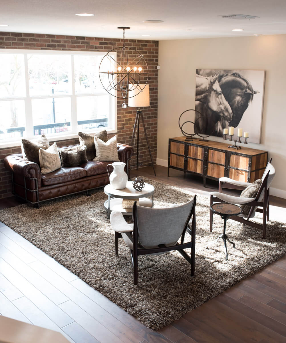 Exposed Brick, Open Metal Lights, And Leather