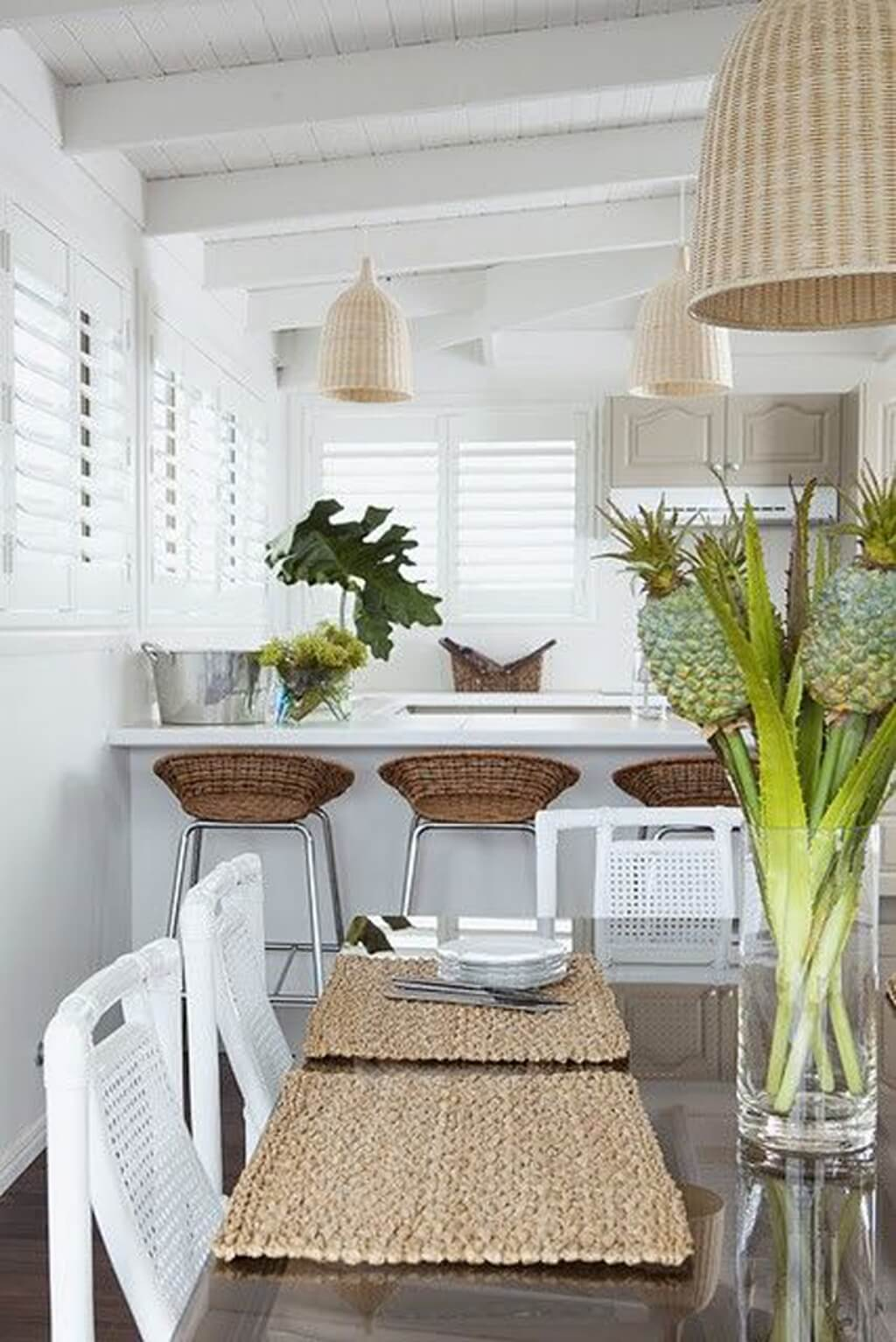 Kitchen Area with Woven Chairs and Shutters
