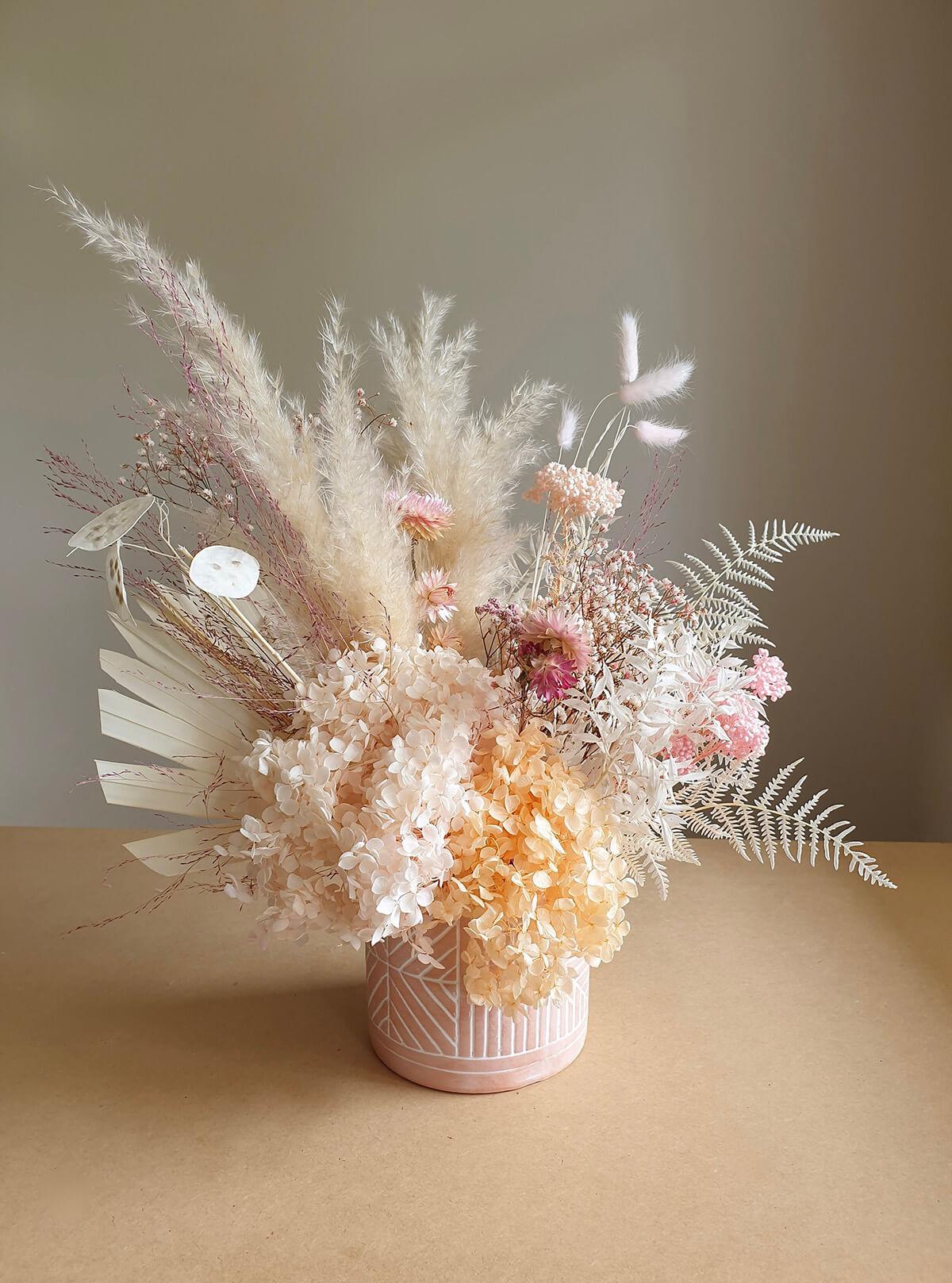 Pale Pink and Orange Floral Arrangement
