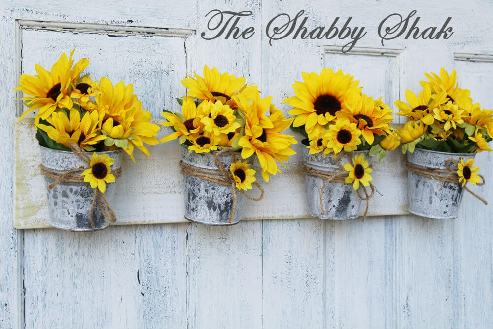Sunflowers Adorn Distressed Wood and Galvanized Buckets