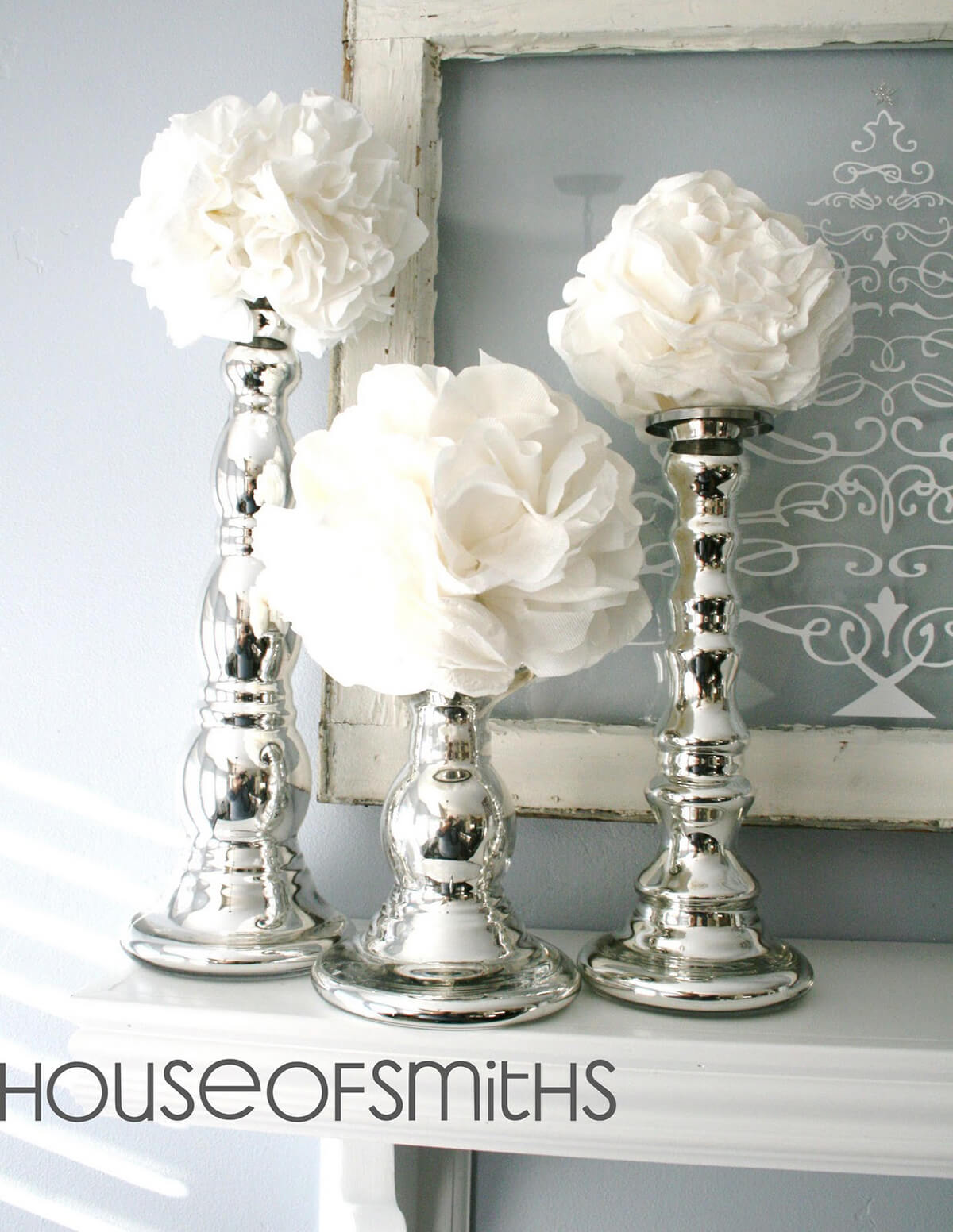 White Flowers Blossoming from Silver Candlesticks
