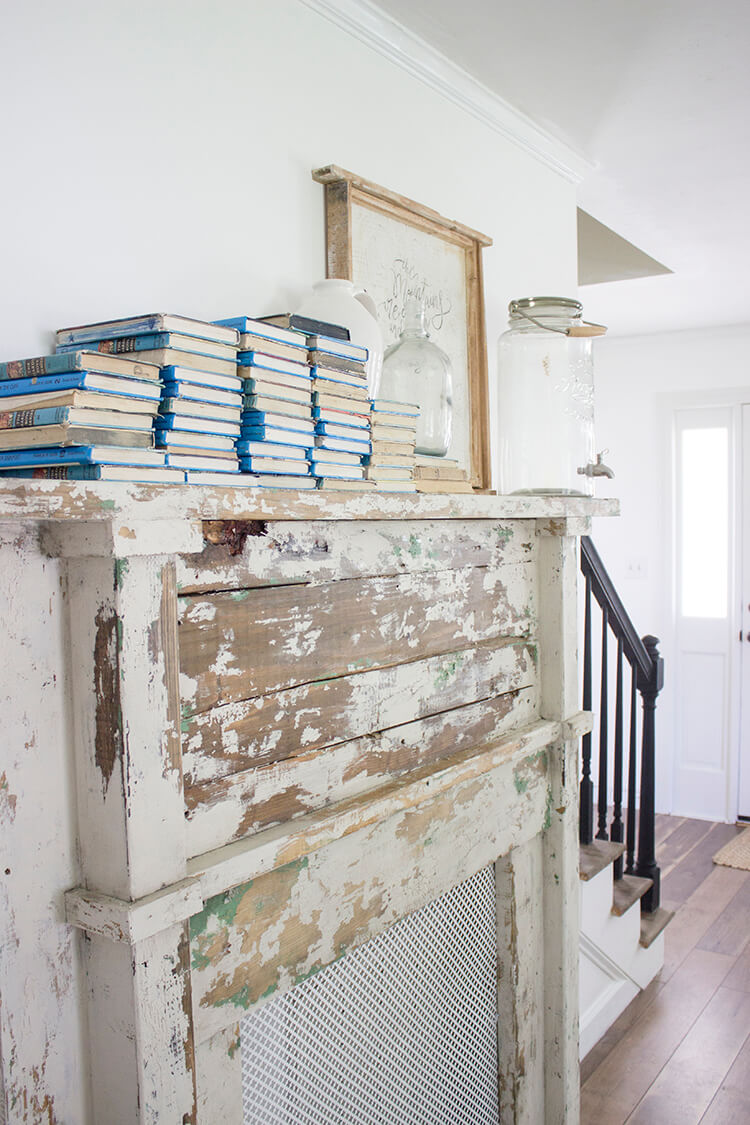 Books and Glass on an Old Farmhouse Fireplace