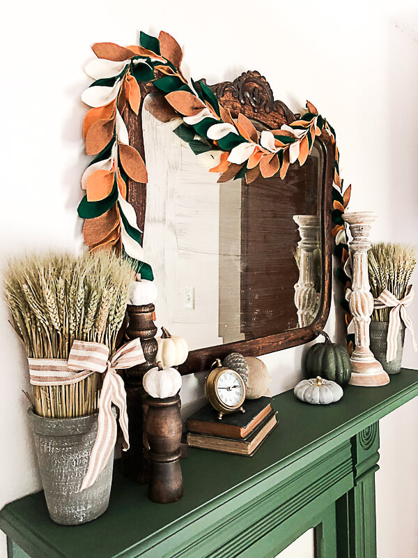 Antique Mirror Surrounded by Wheat and Pumpkins