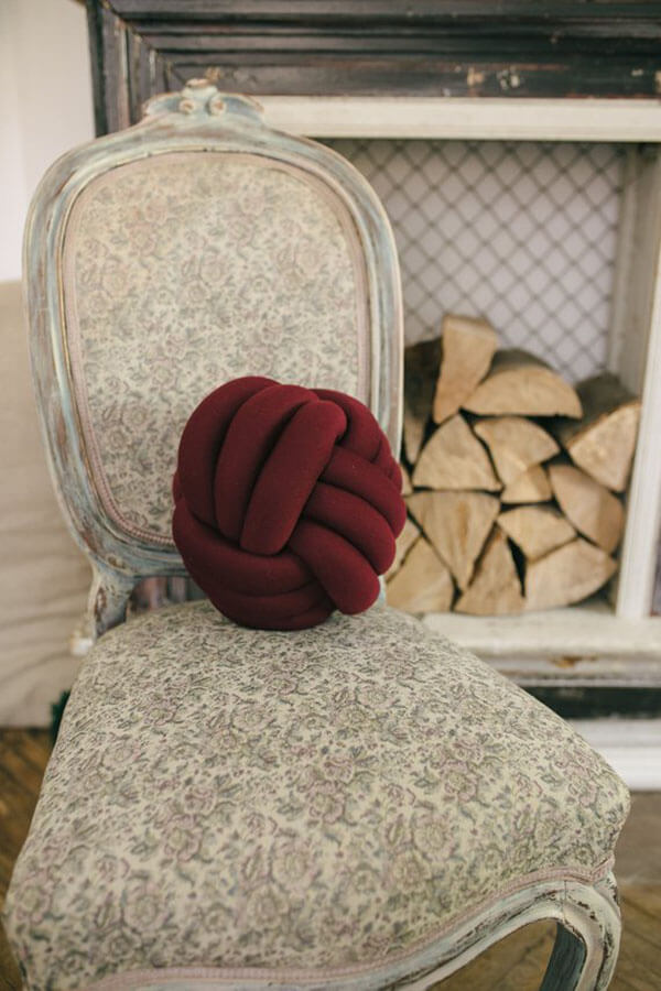 Burgundy Knot Pillow Adds a Decorative Touch