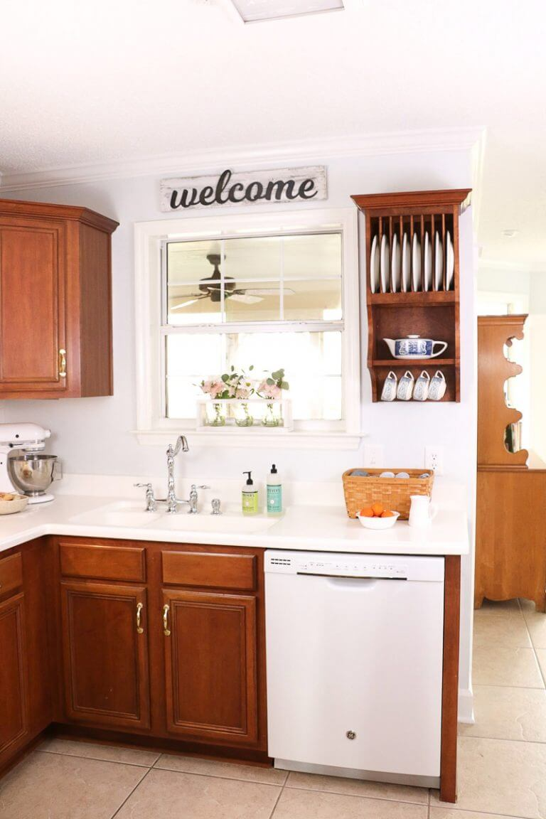 Wood & White Kitchen with Welcome Sign