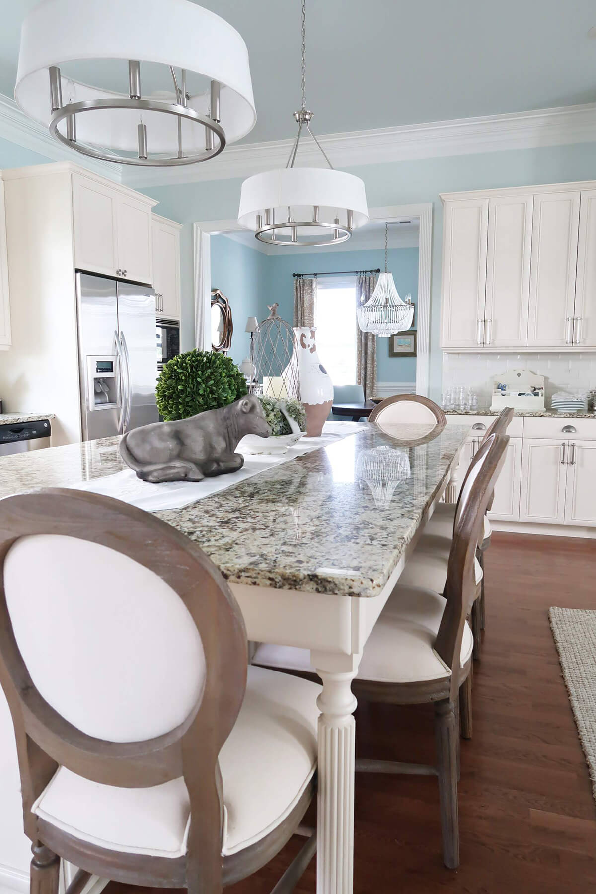 Creamy Blue Kitchen with Marble Top Table