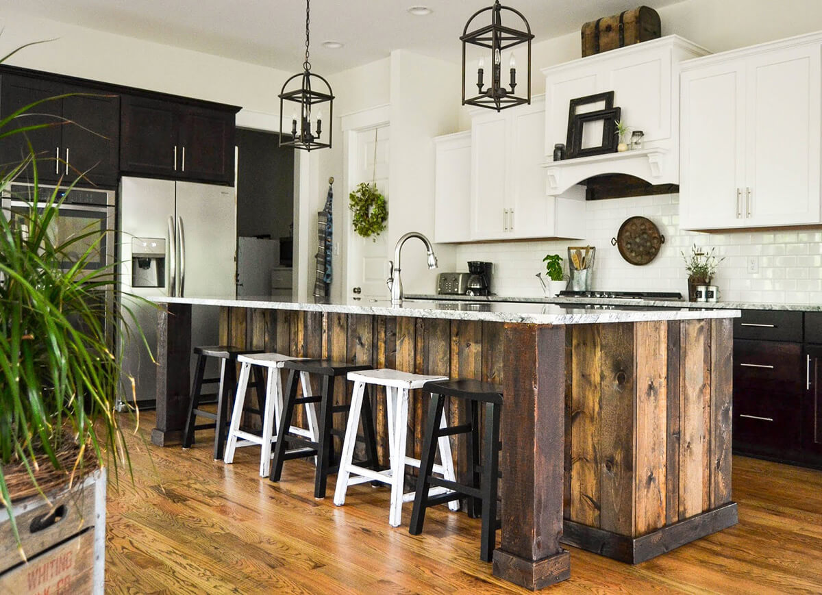 Wood Paneled Kitchen Island with Industrial Lights