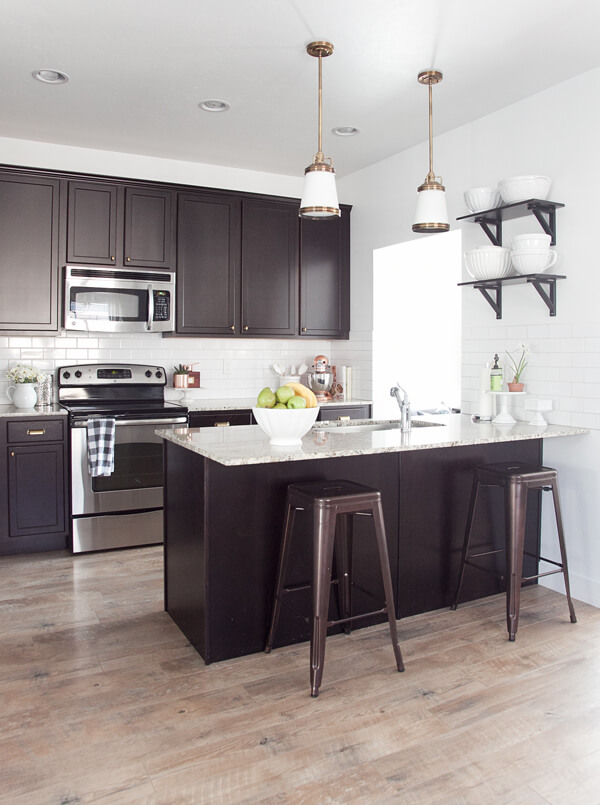 Ebony and Marble Kitchen with Repurposed Lighting