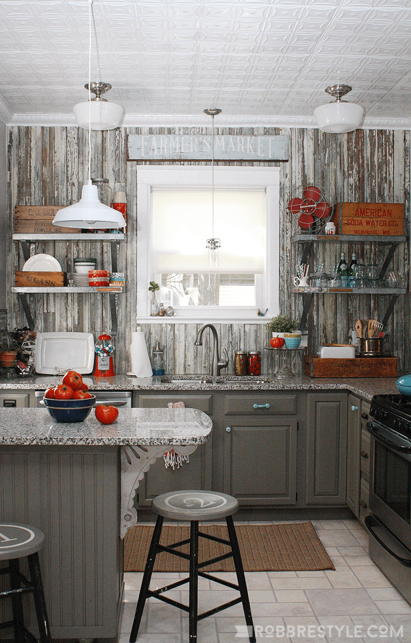 Ash Paneled Kitchen with Farmer's Market Sign