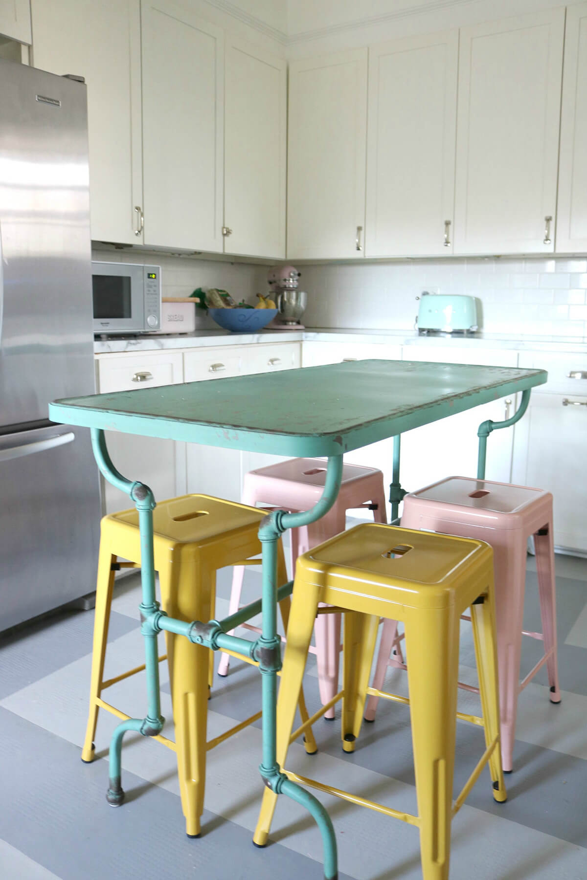 Kitchen with Repurposed Multi-Colored Island Seating