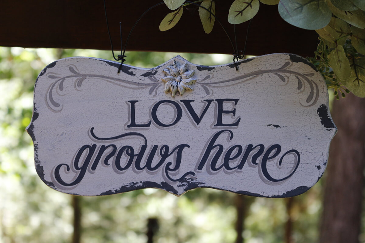 """Love Grows Here"" Garden Sign"