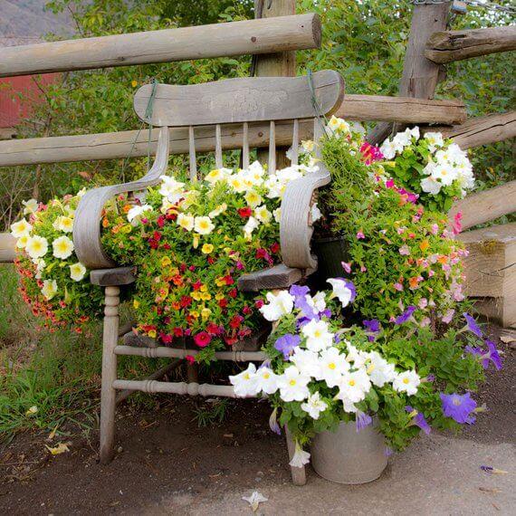 A Floral Extravaganza Garden Chair Planter