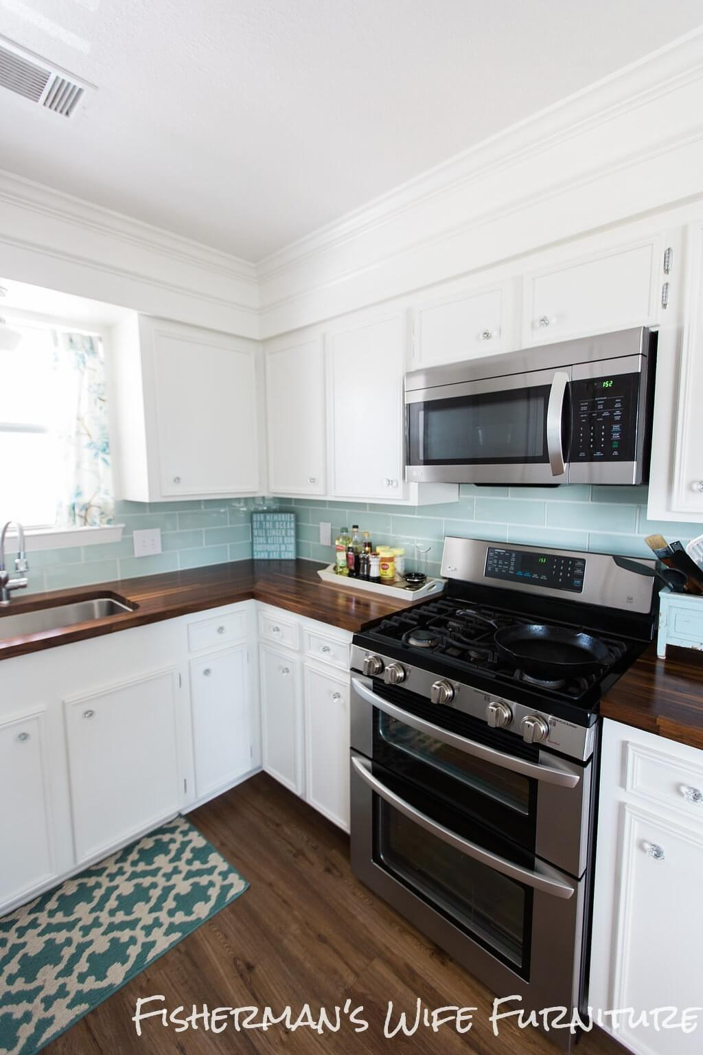 Blue and White Kitchen With Plank Flooring