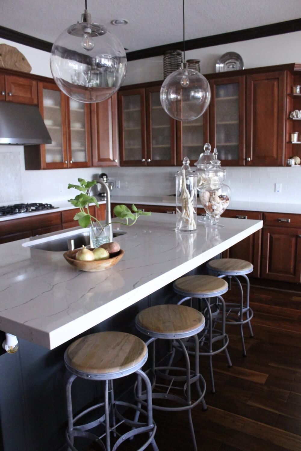 A Coastal Kitchen With Brown Wood Cupboards