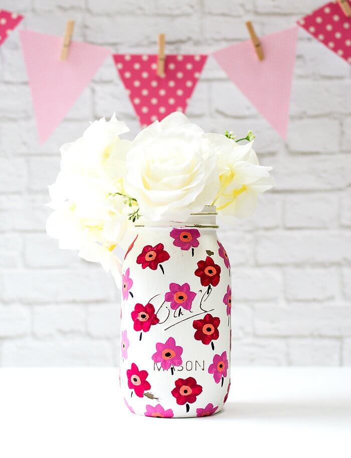 Friendly Pink Flowers on a White Jar