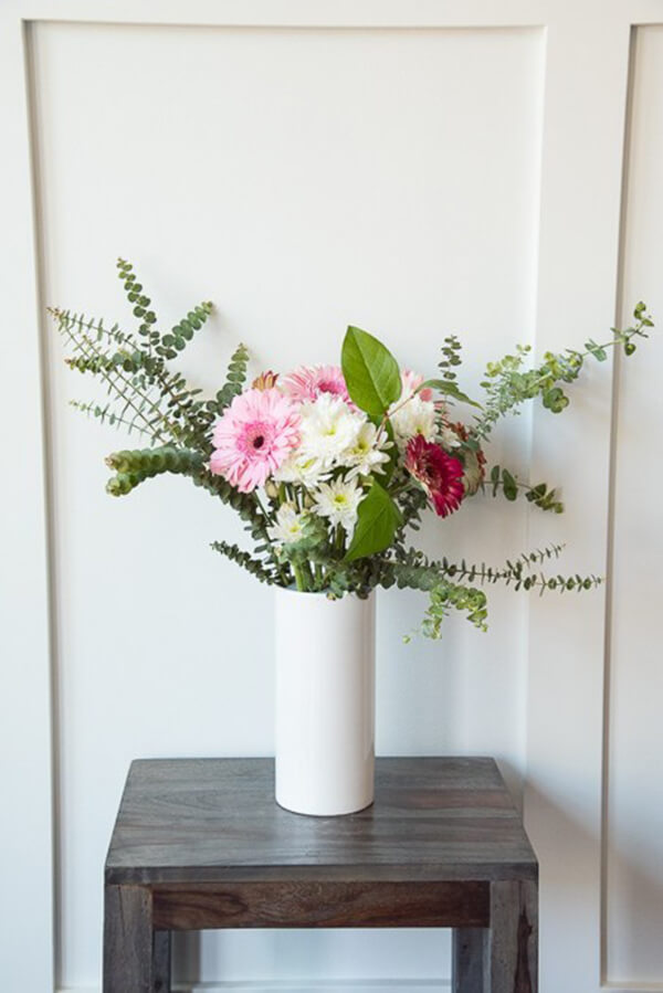 Make a Statement with a Tall White Vase
