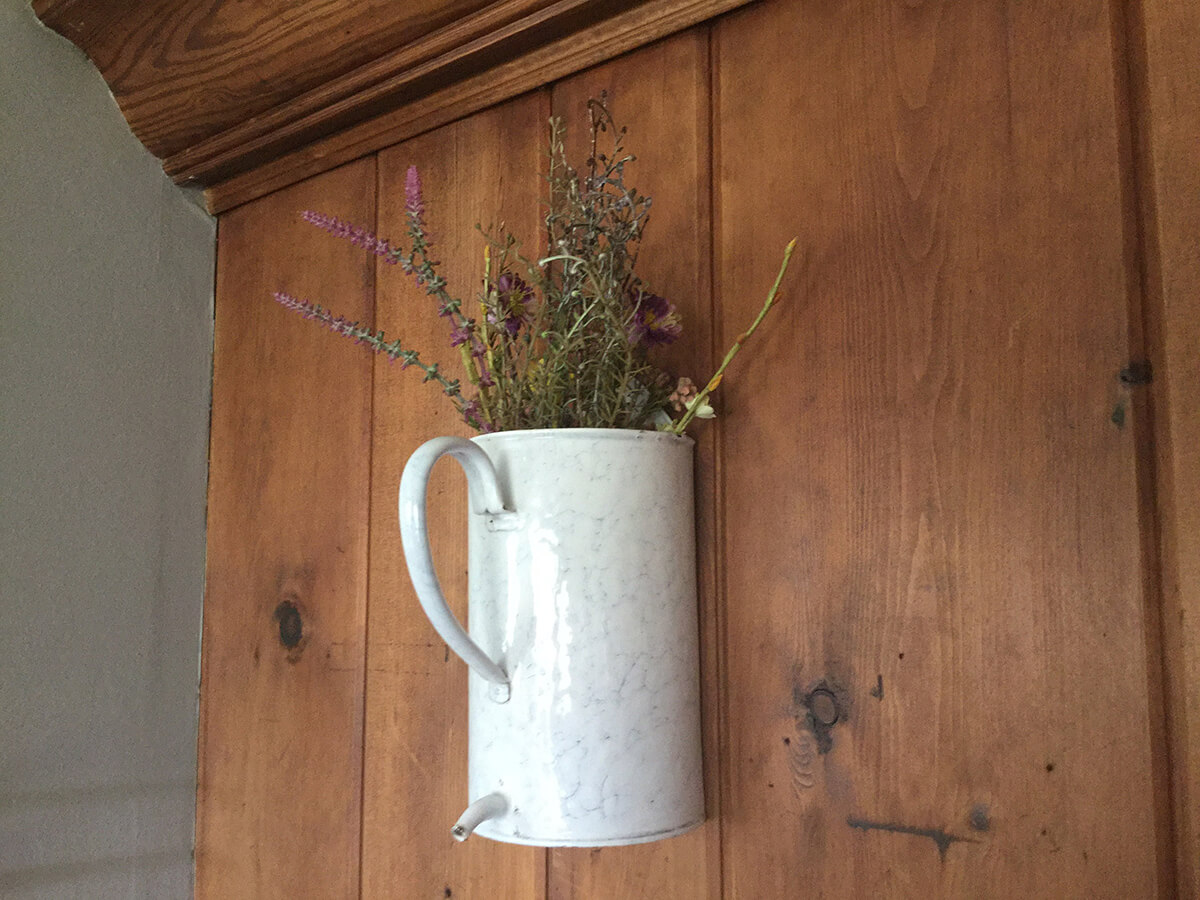 Watering Can Turned Floral Sconce